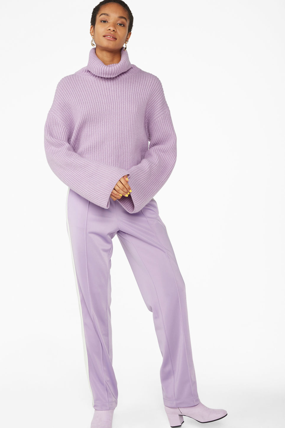 Model side image of Monki turtleneck knit top in purple