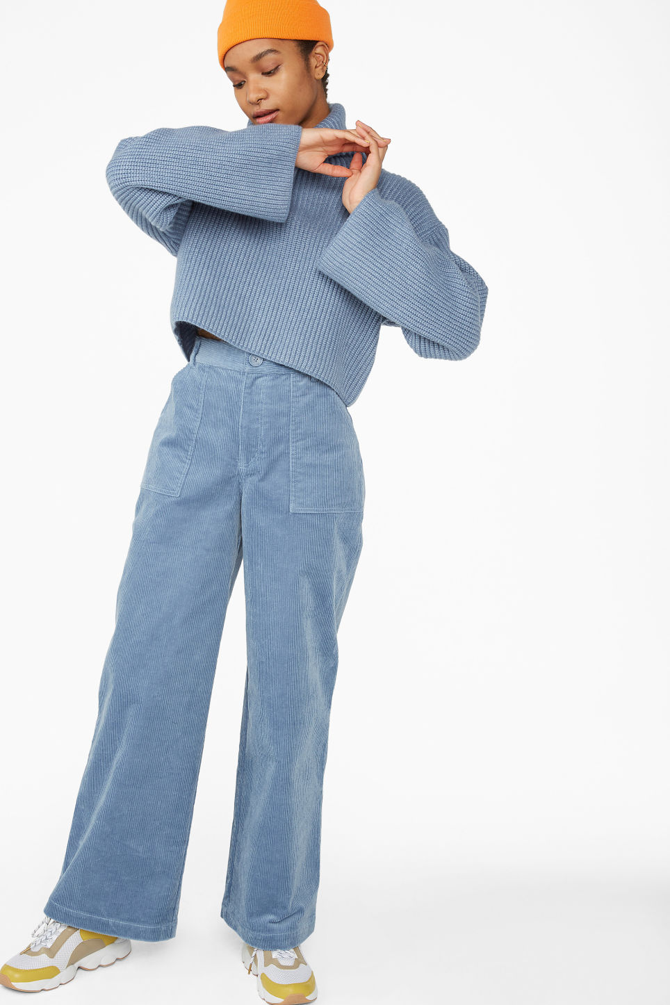 Model side image of Monki turtleneck knit top in blue