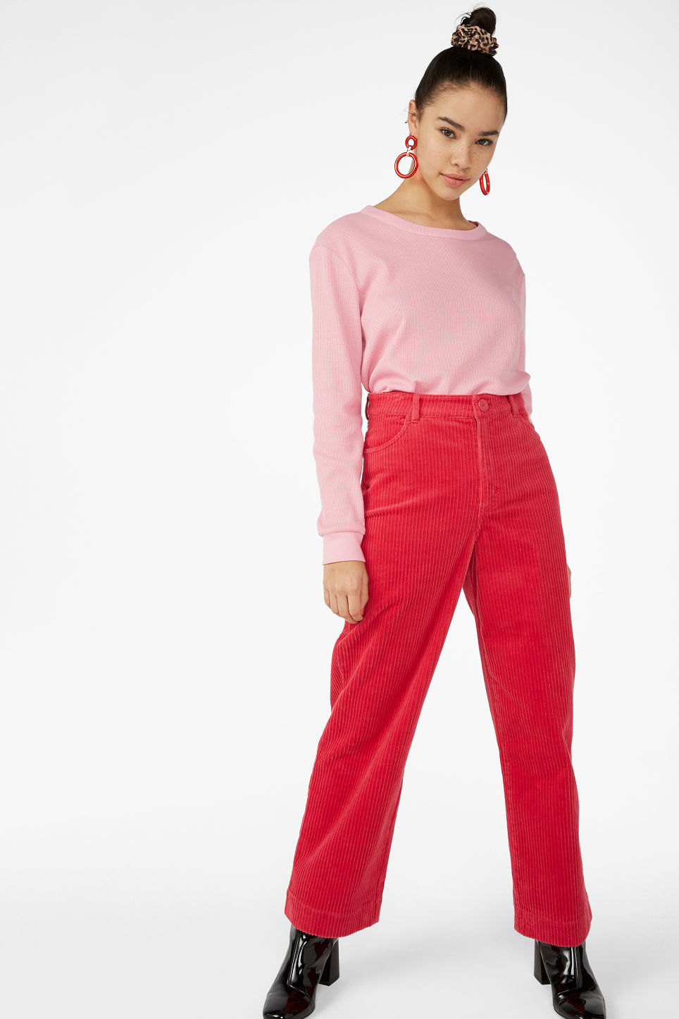 Model side image of Monki waffle knit pullover in pink