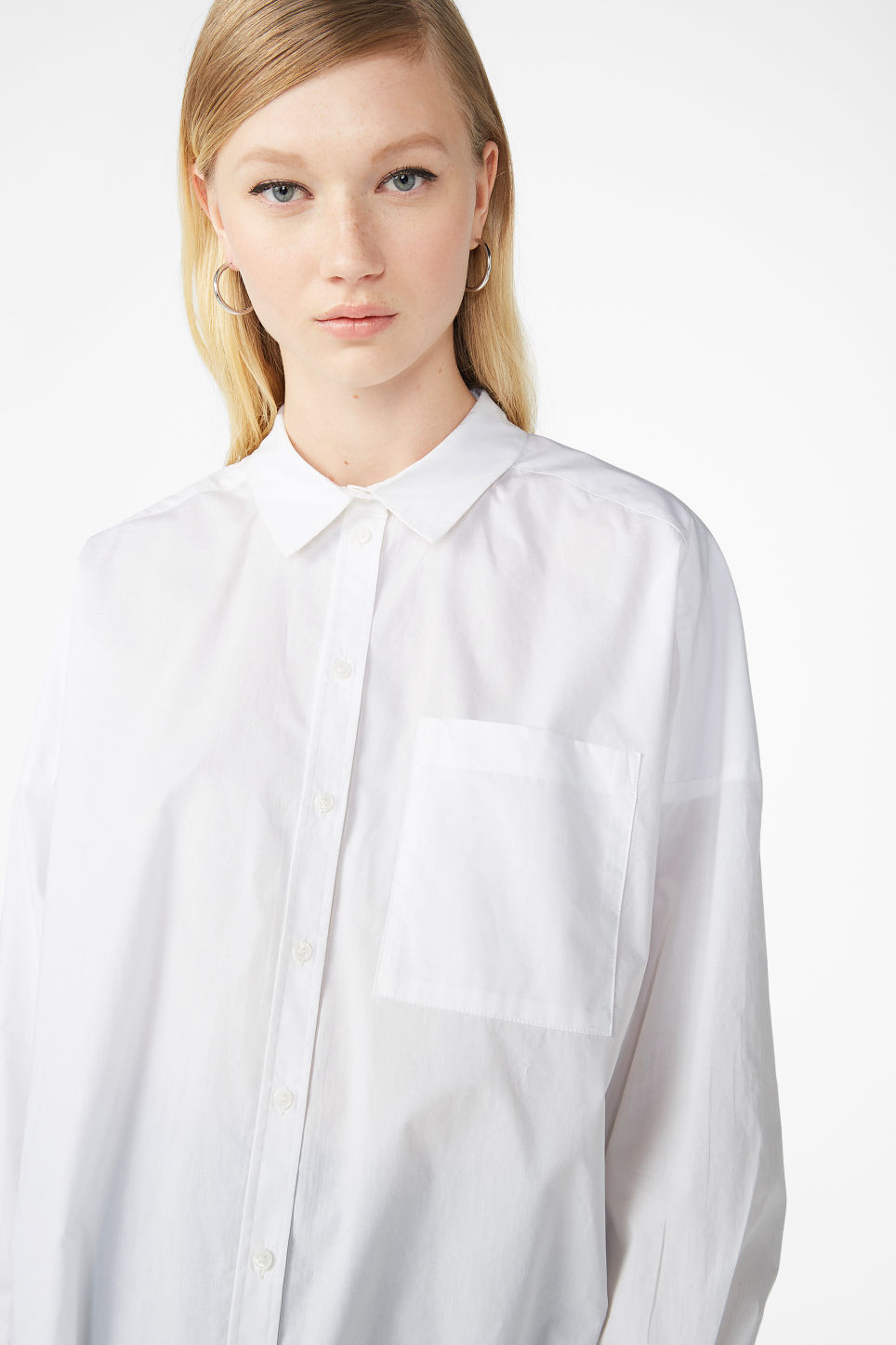 Model front image of Monki below the hip blouse in white