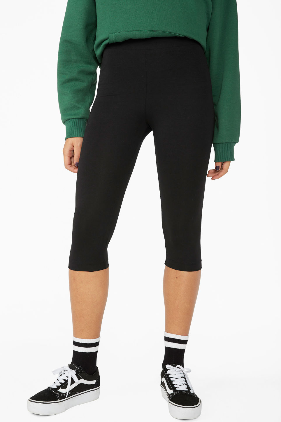 Model side image of Monki cropped leggings in black