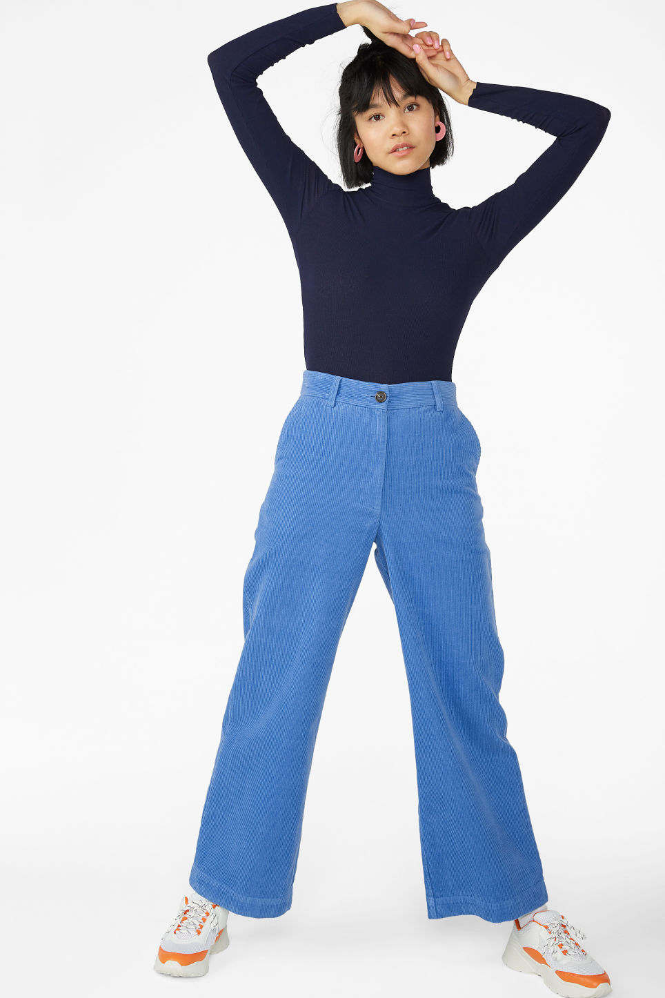 Model side image of Monki raw edges turtleneck top in blue