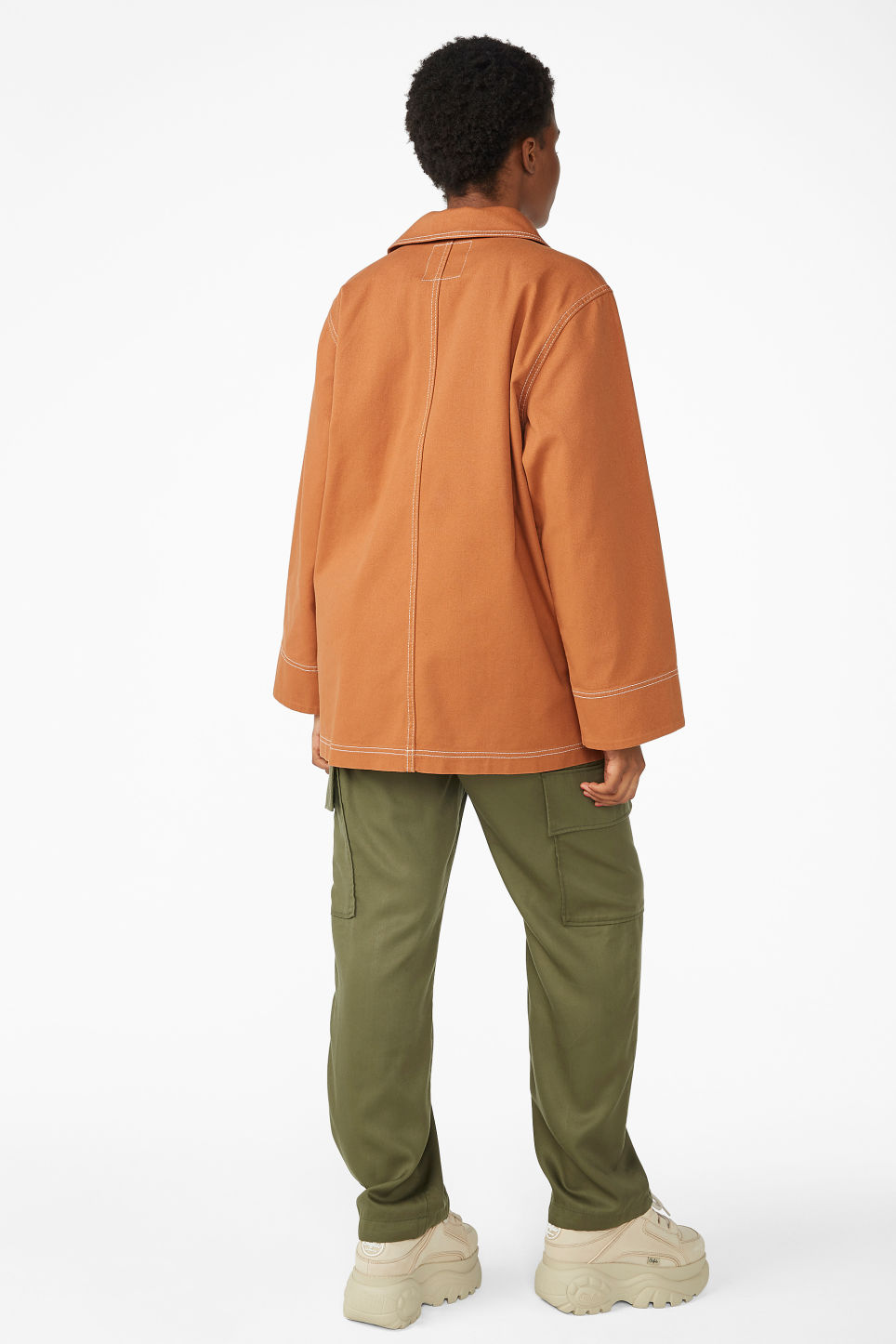 Model back image of Monki contrast stitch jacket in orange
