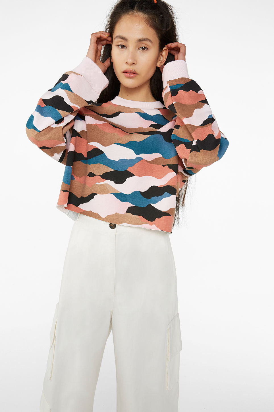Model front image of Monki cropped sweatshirt  in pink