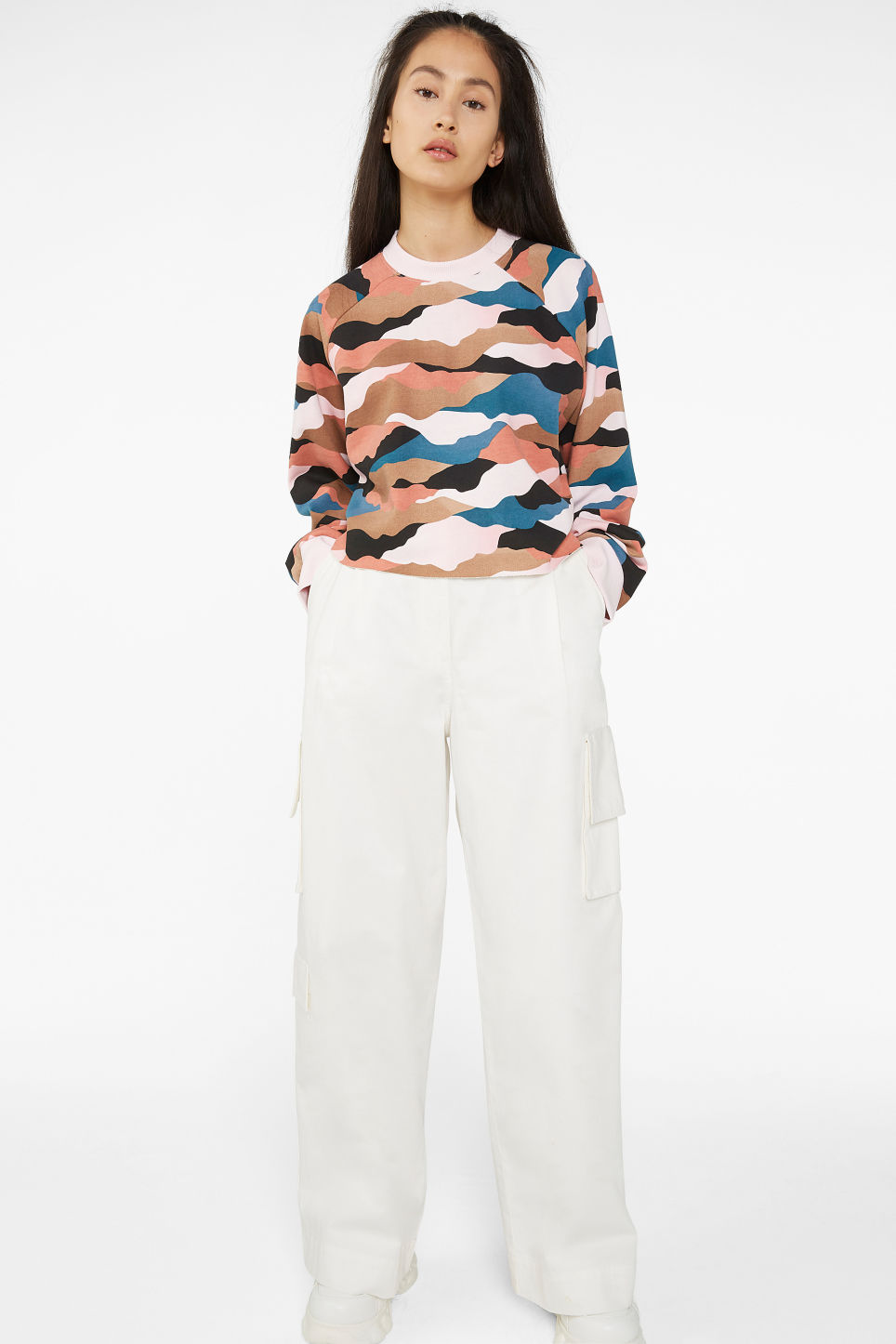 Model side image of Monki cropped sweatshirt  in pink