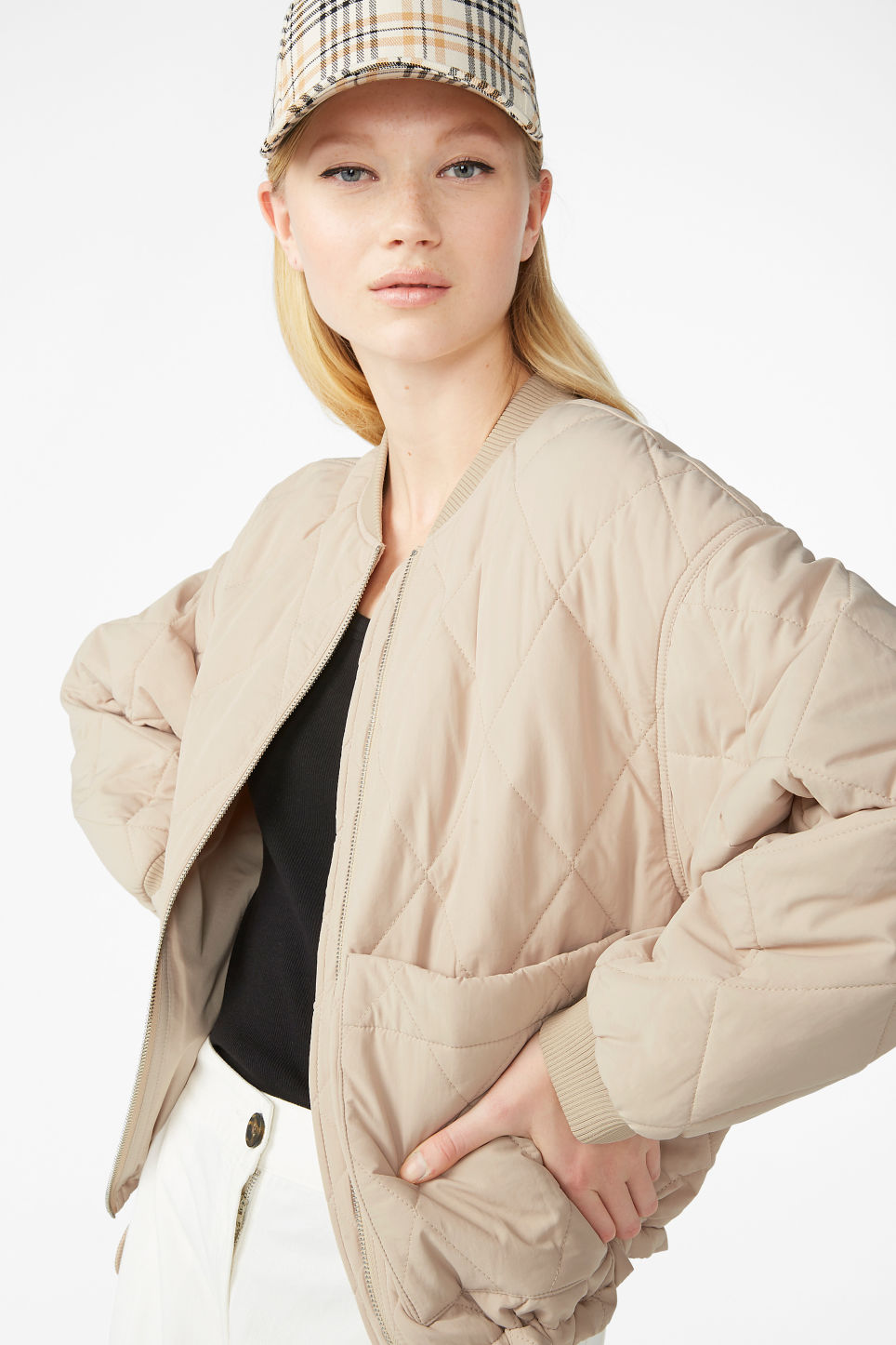 Model front image of Monki quilted jacket in beige