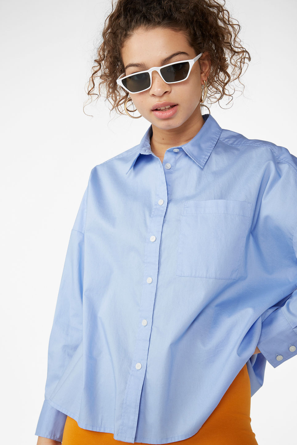 Model front image of Monki boxy button-up blouse in blue