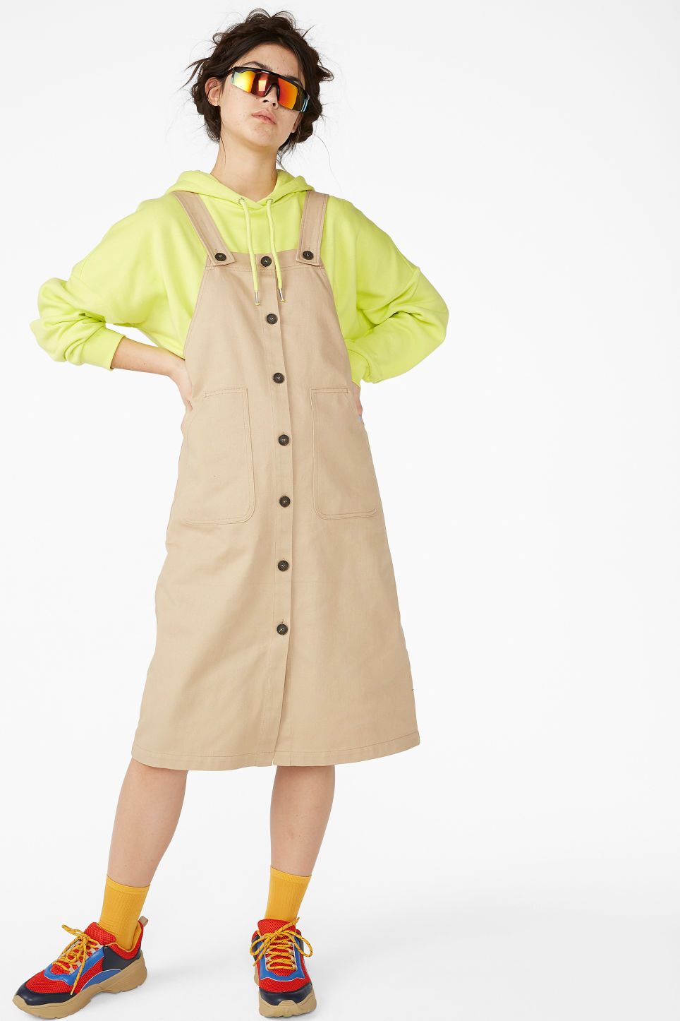 Model front image of Monki buttoned dungaree dress in beige
