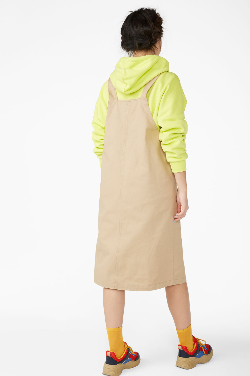 Model back image of Monki buttoned dungaree dress in beige