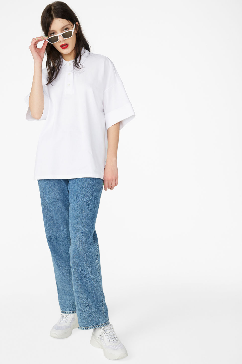 Model side image of Monki oversized polo top in white