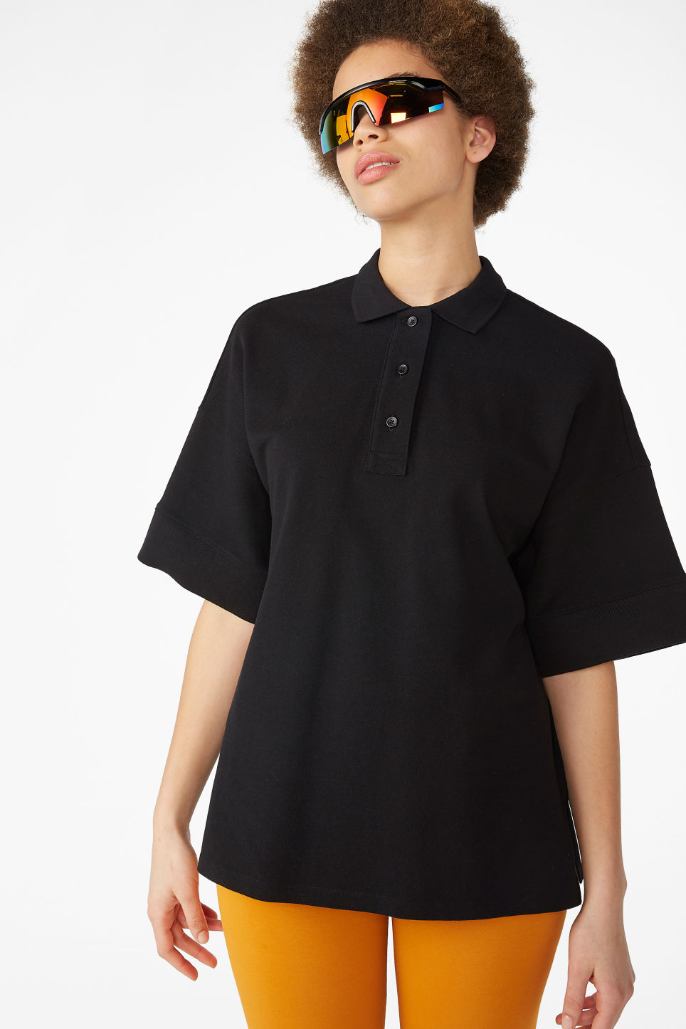 Model front image of Monki oversized polo top in black
