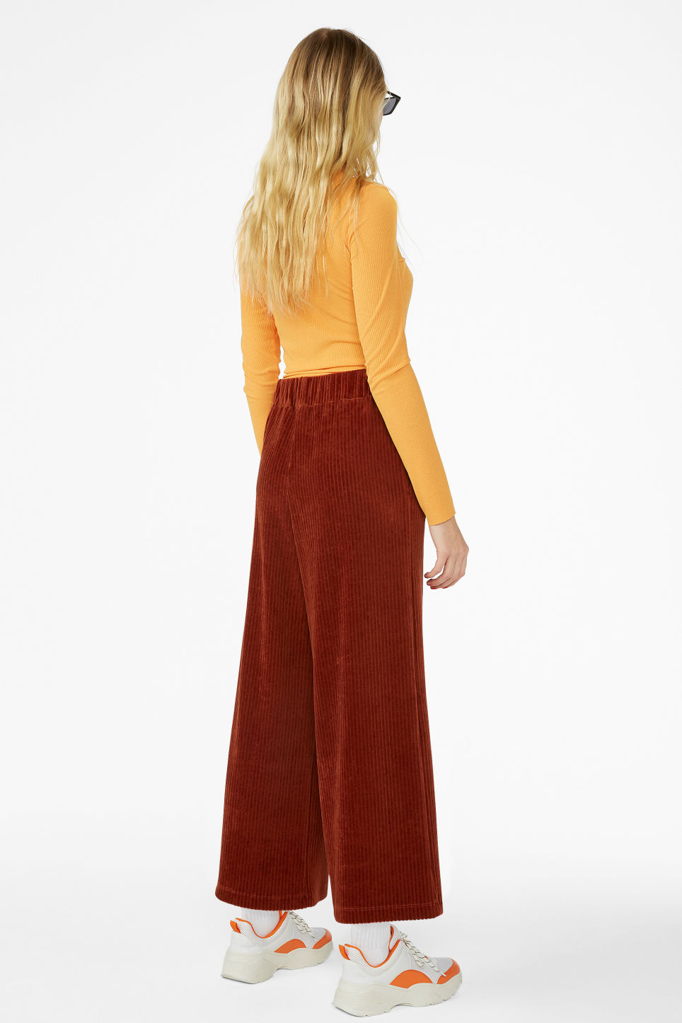 Model back image of Monki cropped ribbed velour trousers in orange