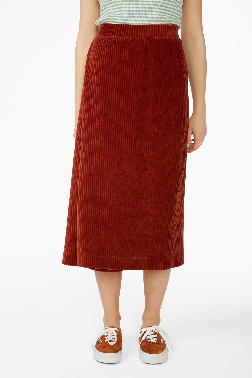 Model side image of Monki soft ribbed velour skirt in orange