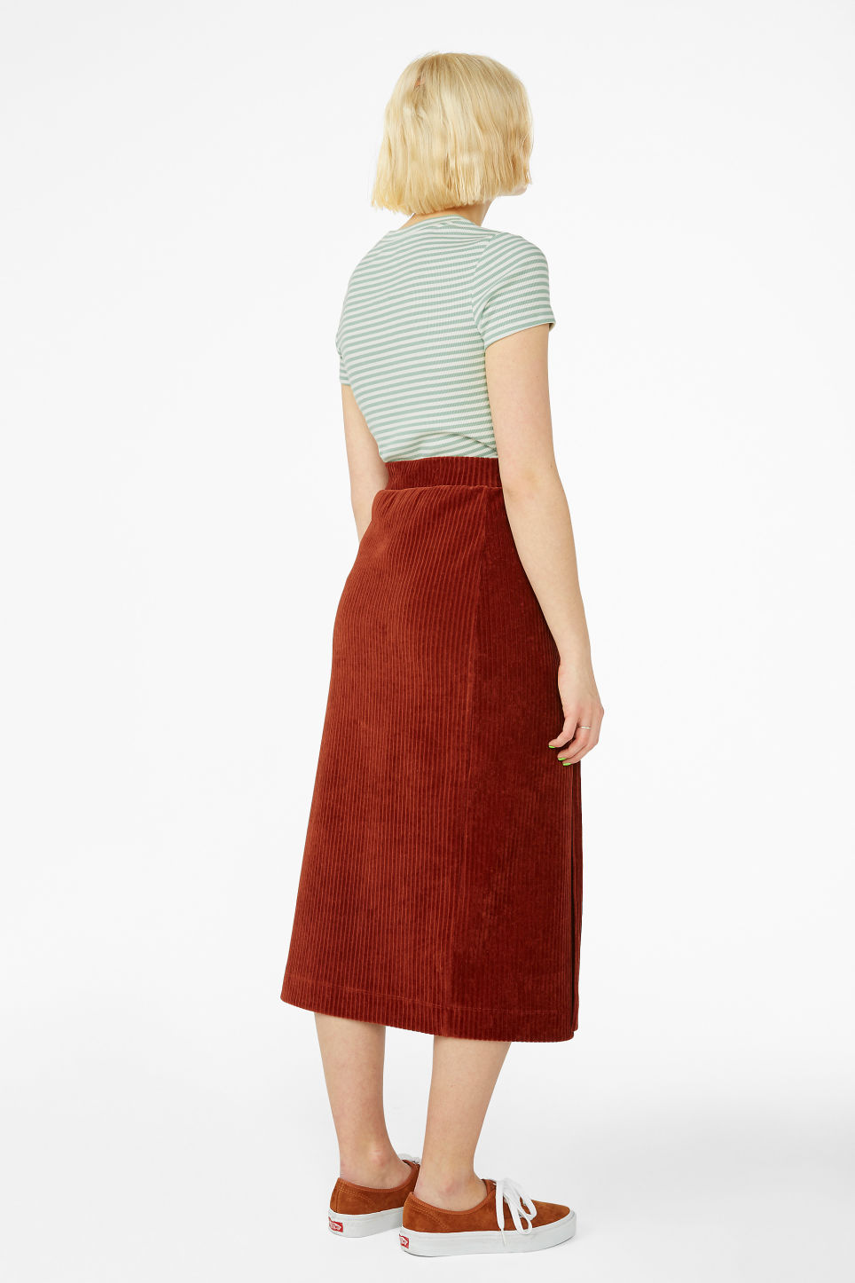 Model back image of Monki soft ribbed velour skirt in orange