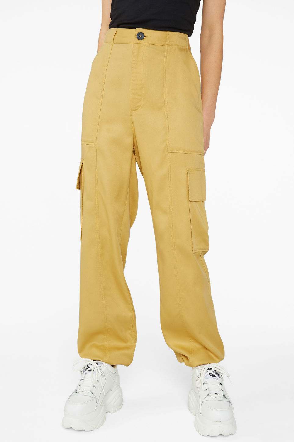 Model side image of Monki utility trousers  in yellow