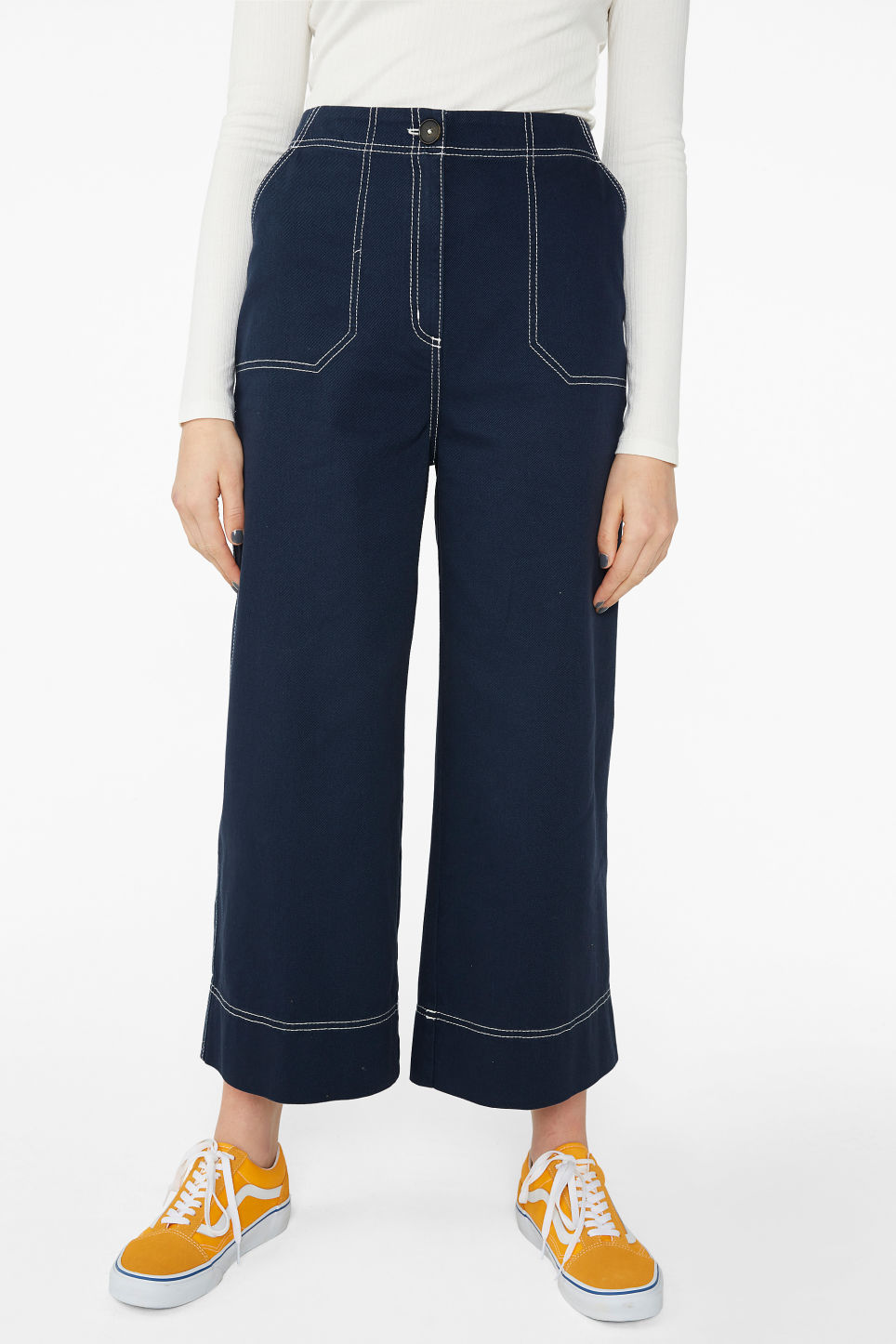 Model side image of Monki contrast stitch utility trousers in blue