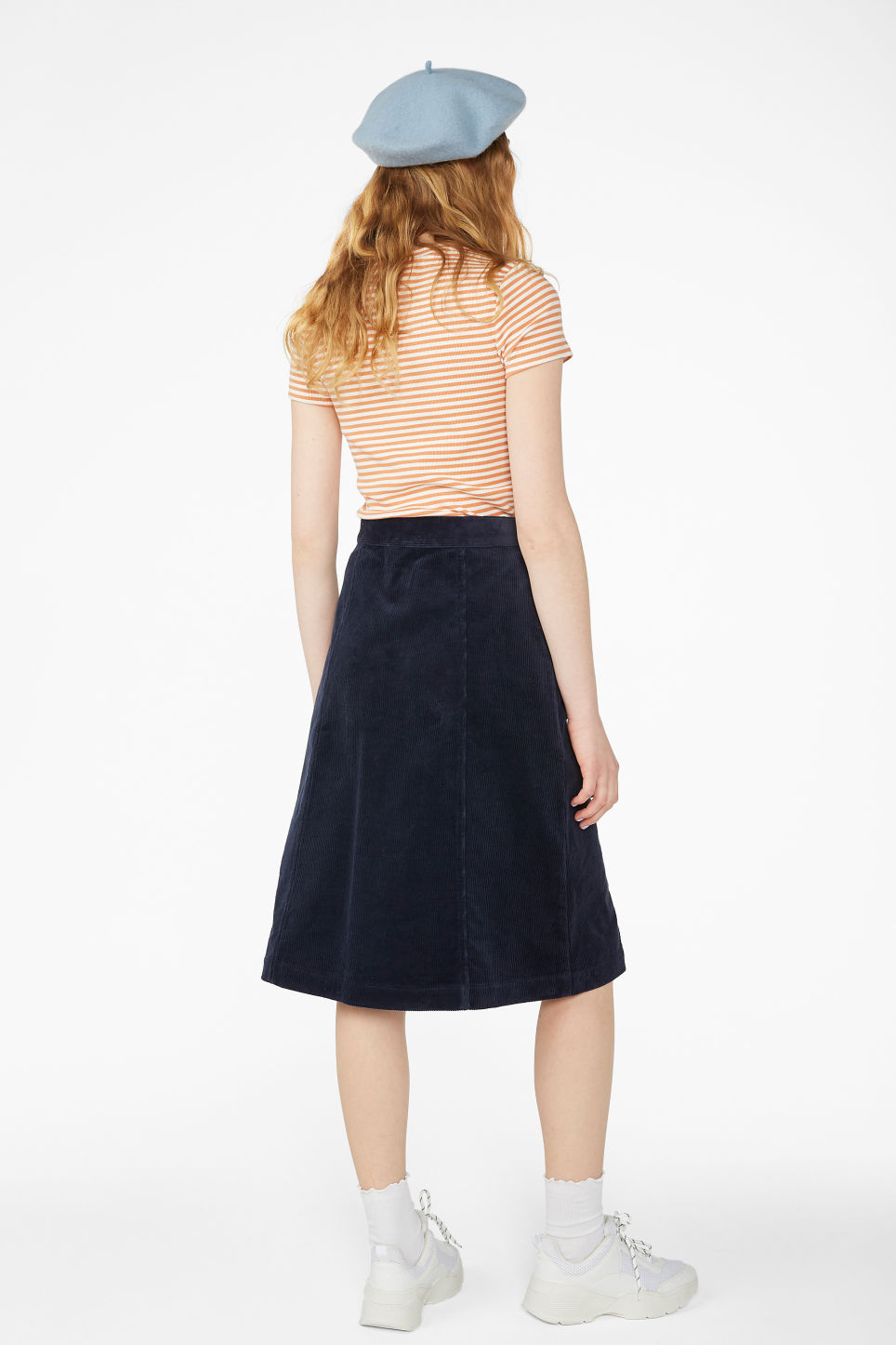 Model back image of Monki midi corduroy skirt in blue