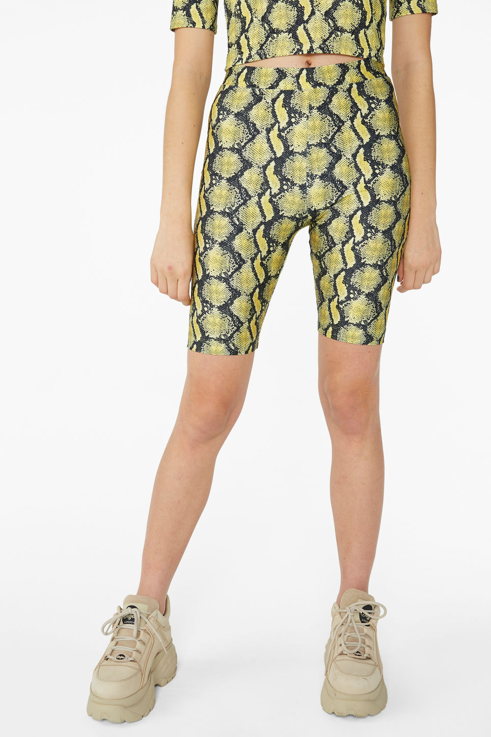 Model side image of Monki bicycle shorts  in yellow