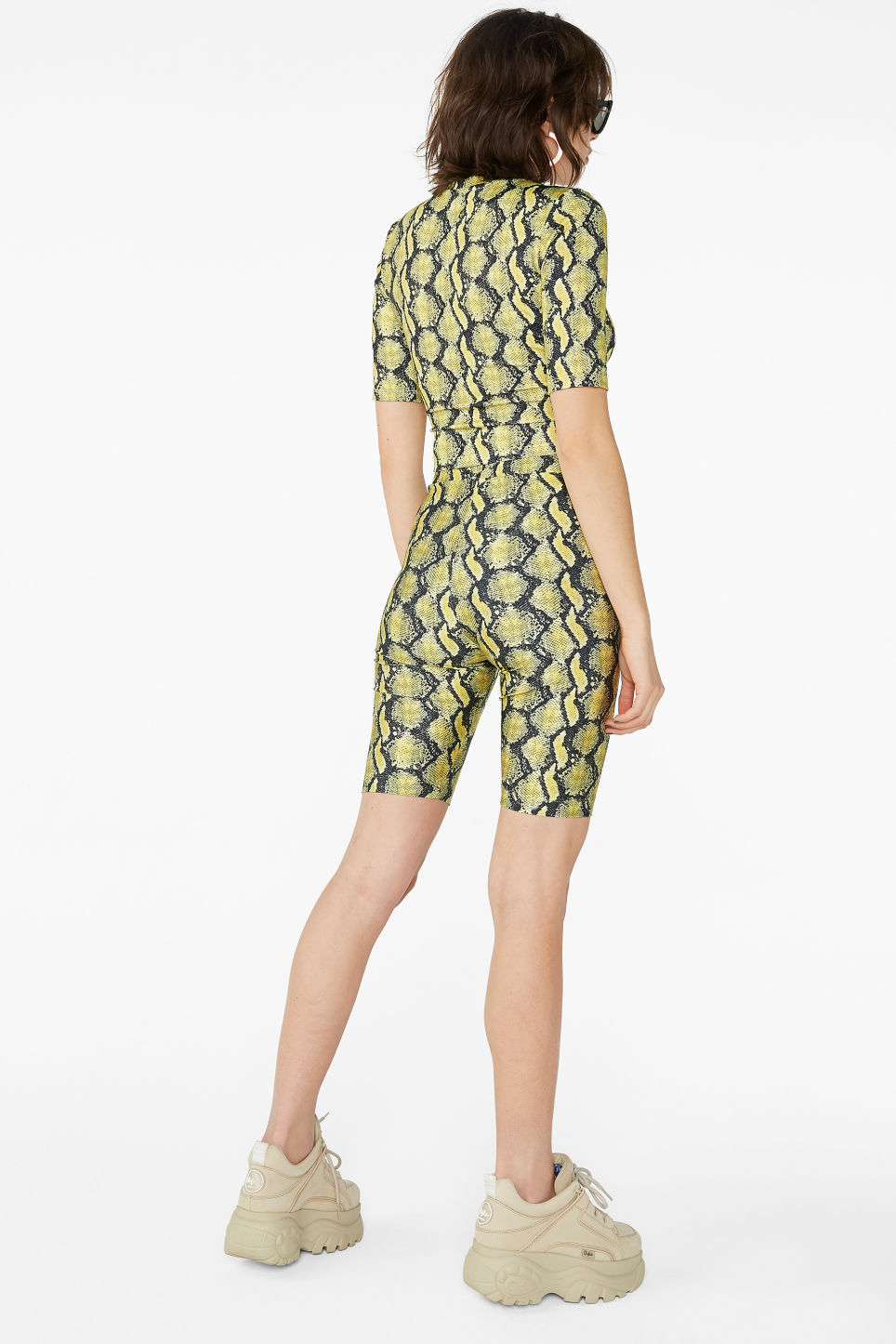Model back image of Monki bicycle shorts  in yellow