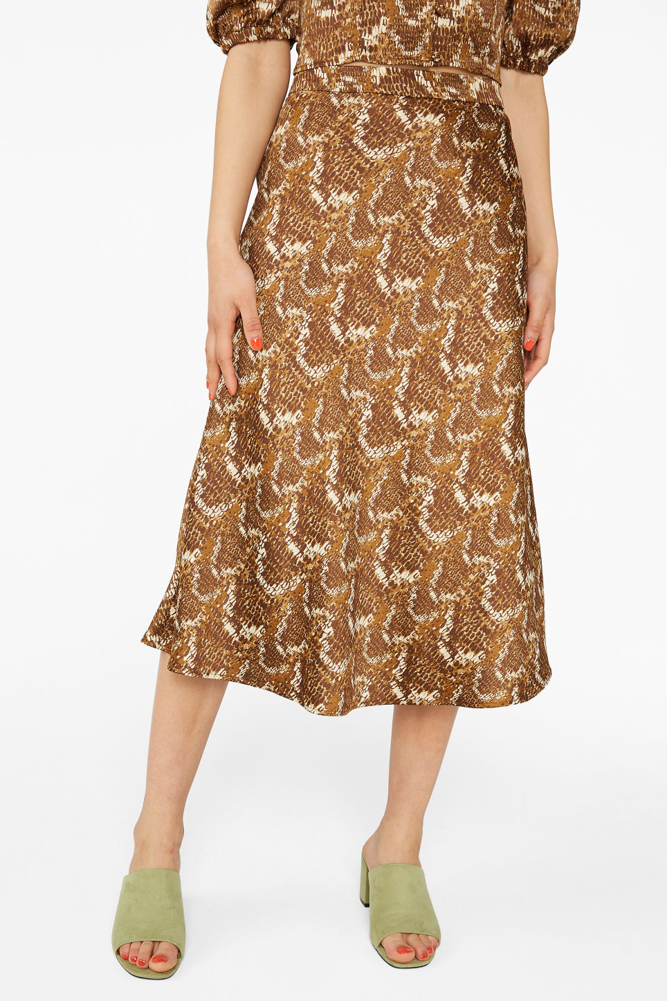 Model side image of Monki a-line skirt in brown