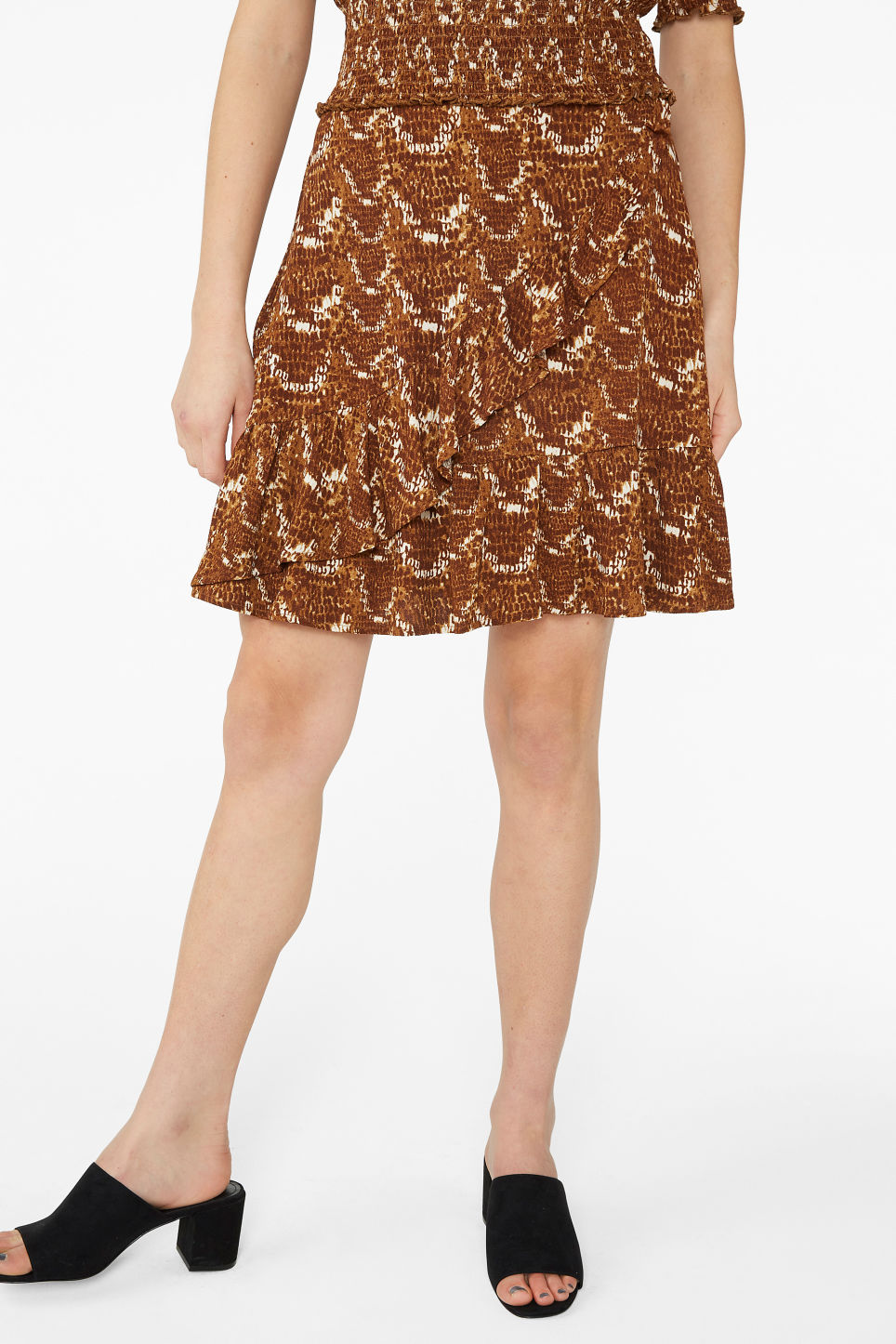 Model side image of Monki snake print ruffle skirt in yellow