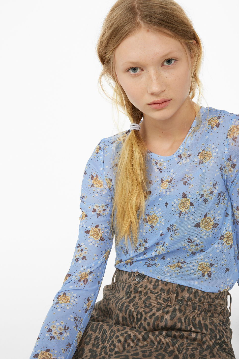Model front image of Monki long-sleeved mesh top in blue