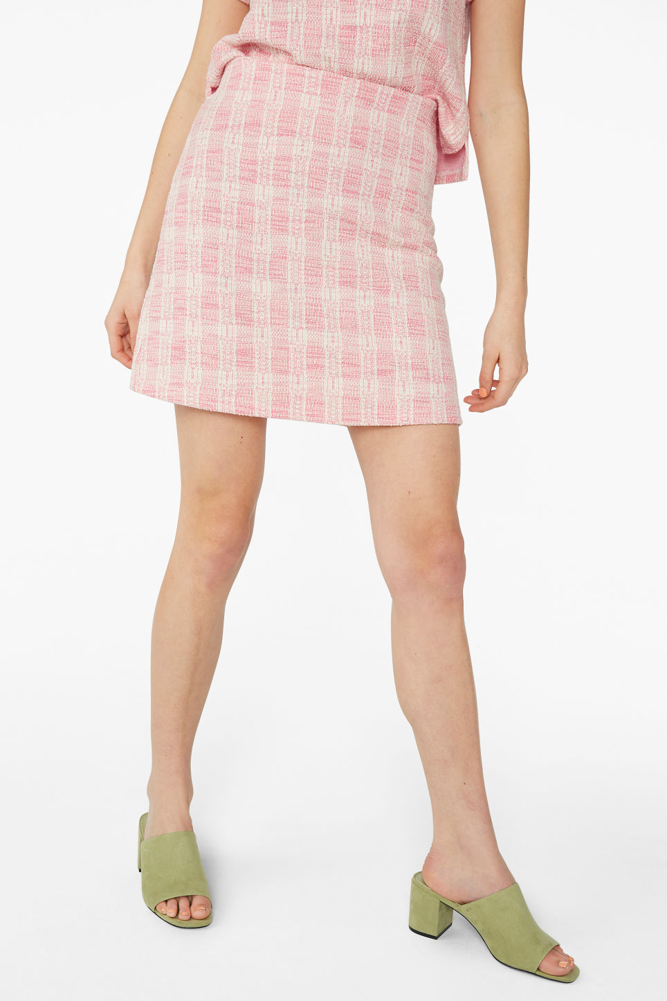 Model side image of Monki boucle mini skirt in pink