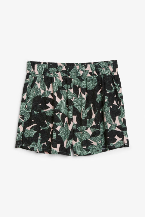 Front image of Monki loose fit shorts in green