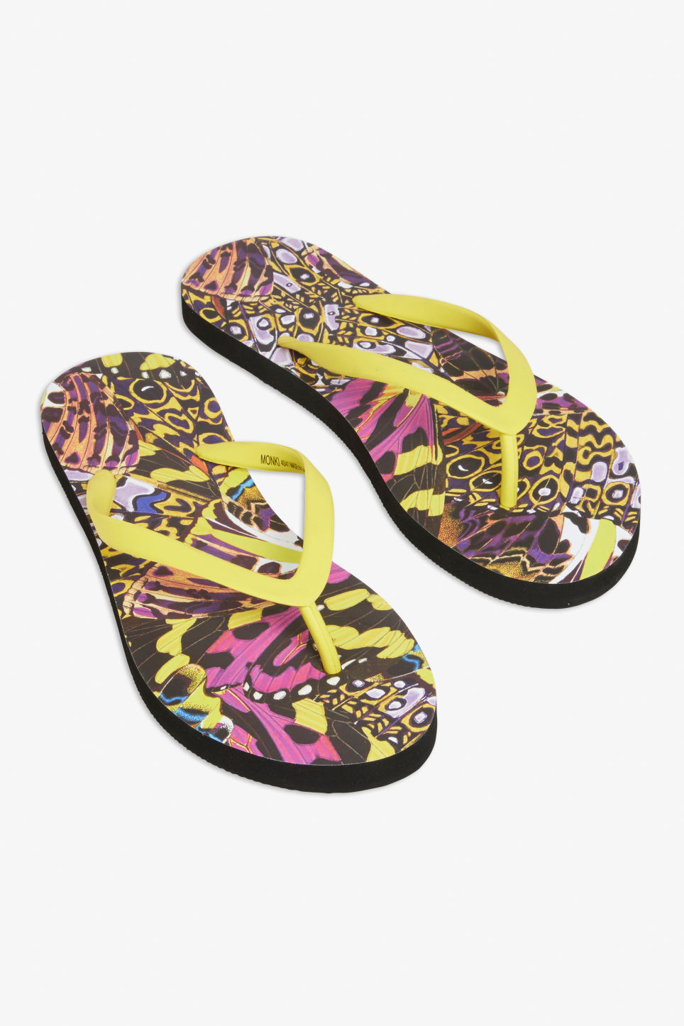 Front image of Monki flip flops in yellow