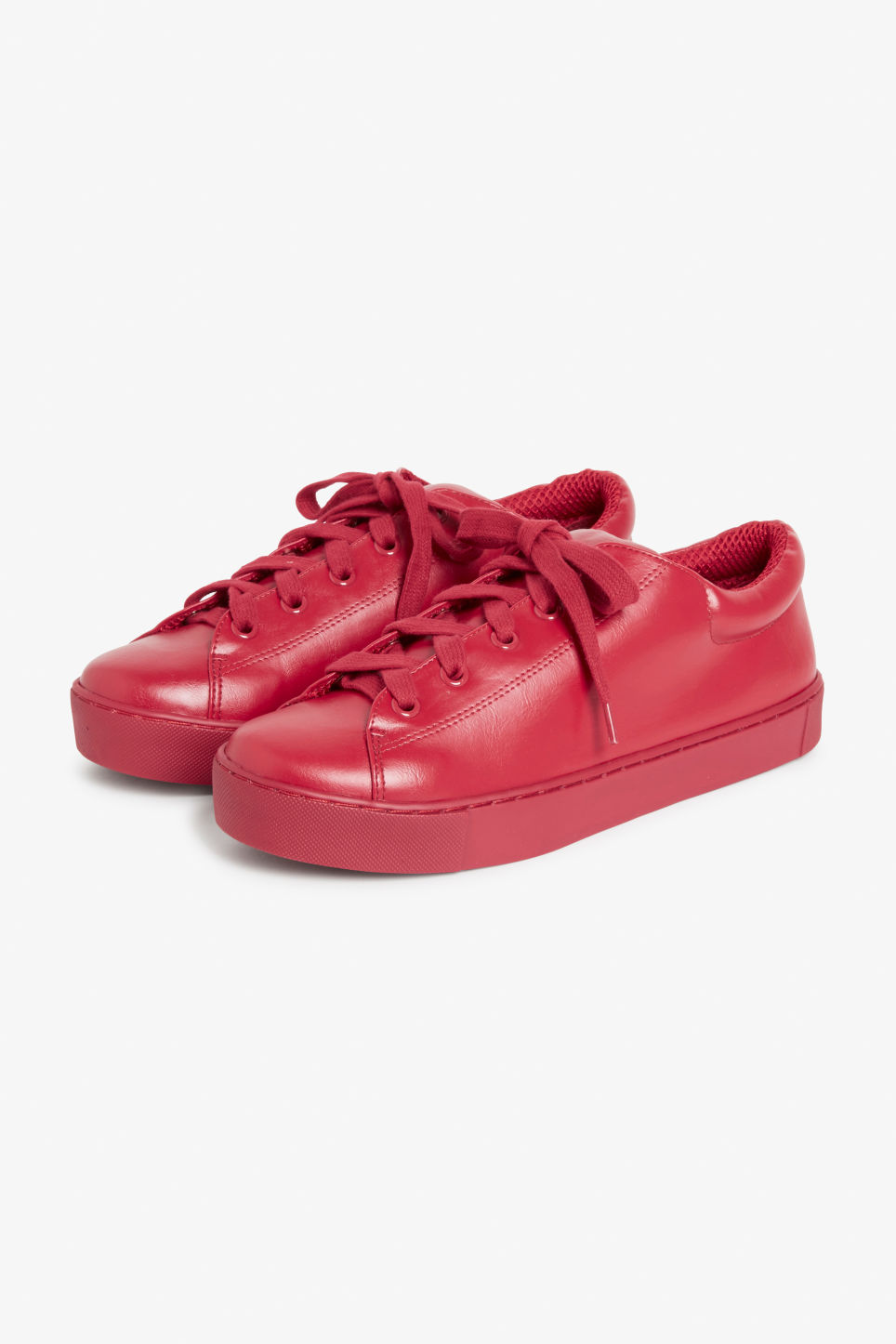 Front image of Monki lace-up sneakers in red