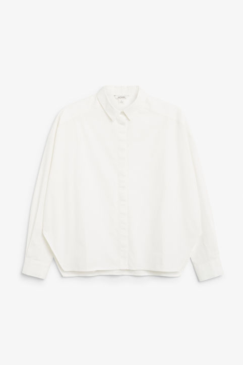 Front image of Monki hidden button cotton blouse in white