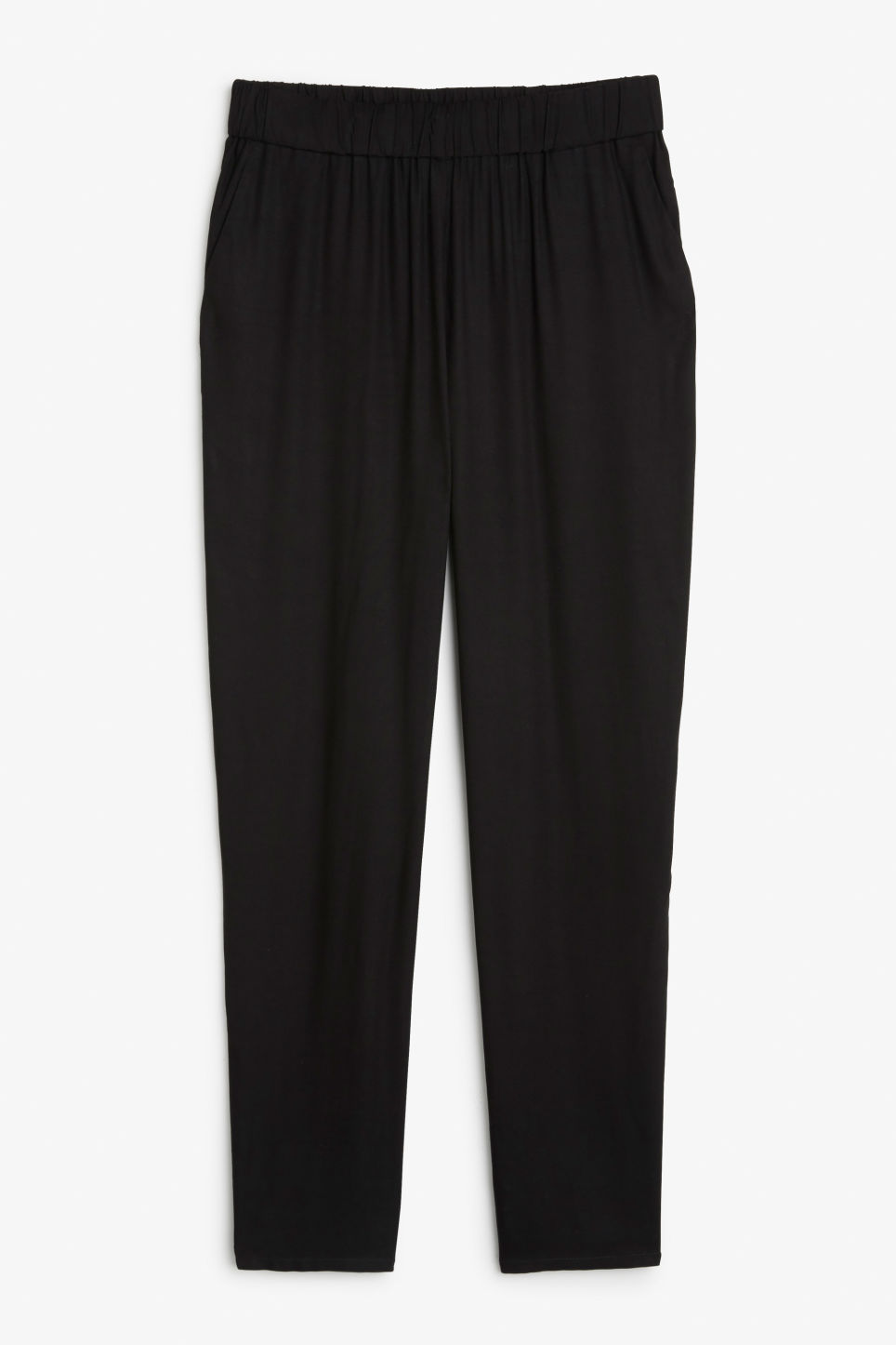 Front image of Monki tapered trousers in black