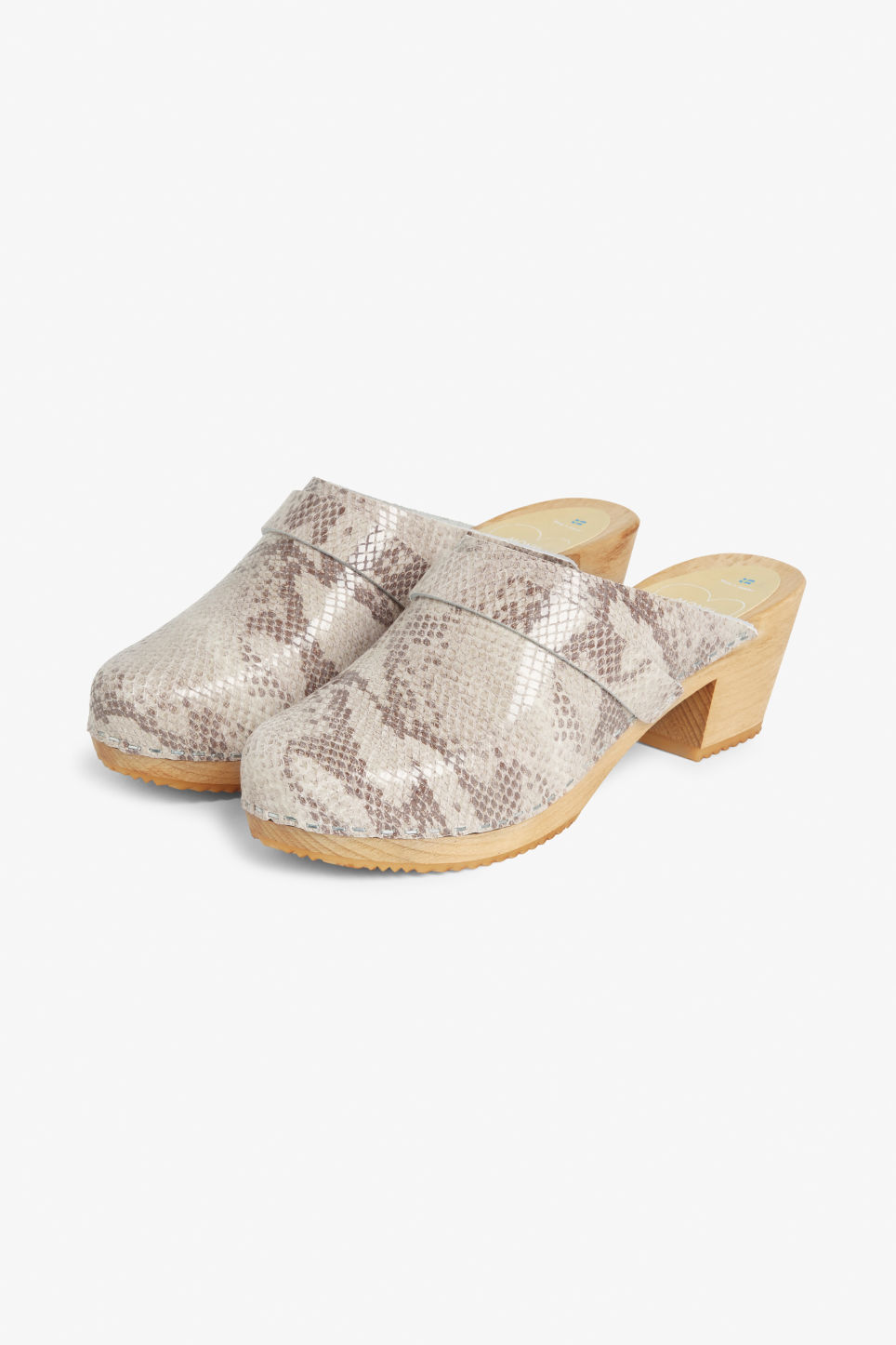 Front image of Monki moheda snake skin pattern clogs in black