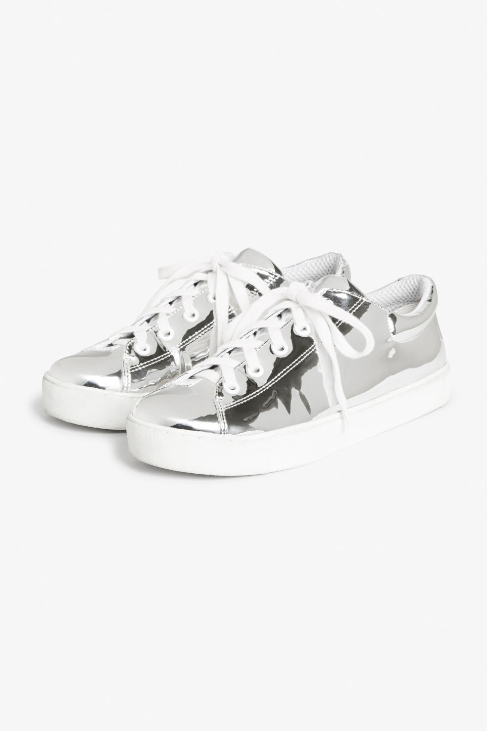 Front image of Monki metallic sneakers in silver