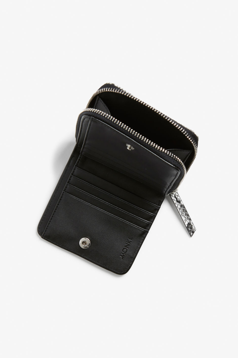 Side image of Monki coin purse wallet in grey