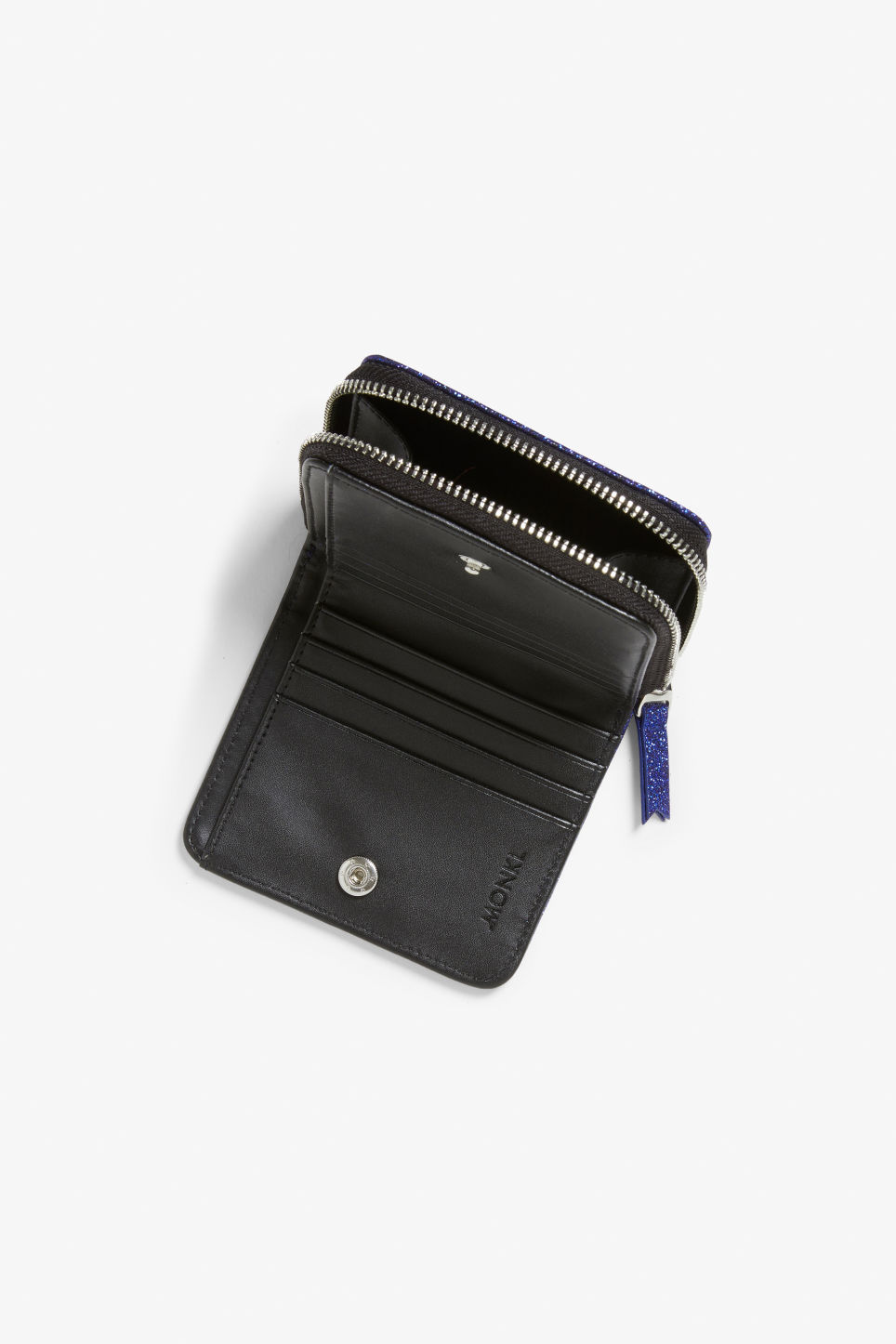 Side image of Monki coin purse wallet in blue