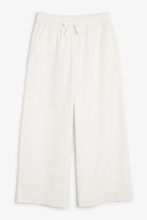 Front image of Monki high waist trousers in white