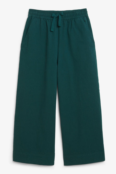 Front image of Monki wide leg canvas trousers in green