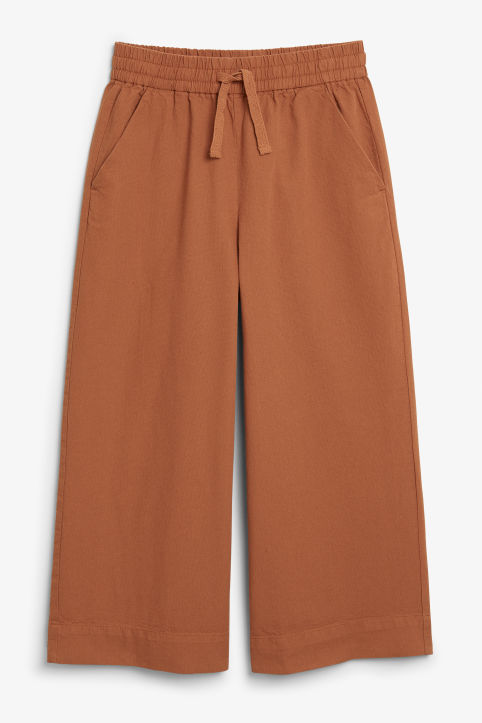 Front image of Monki wide leg canvas trousers in orange