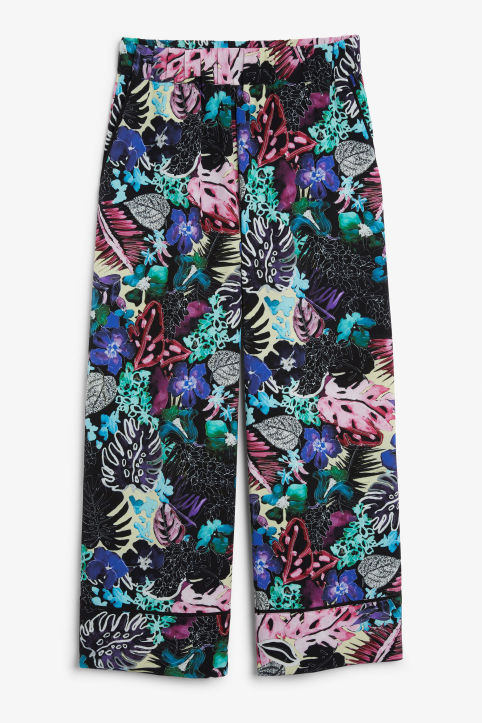 Front image of Monki wide swing trousers in black