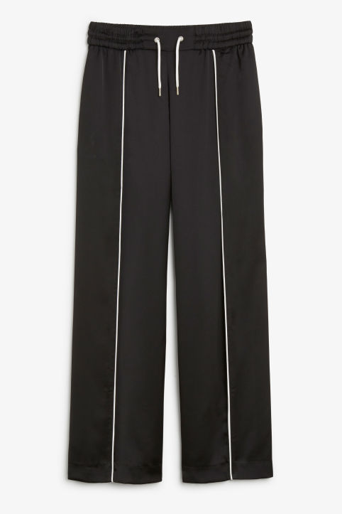 Front image of Monki wide sporty trousers in black