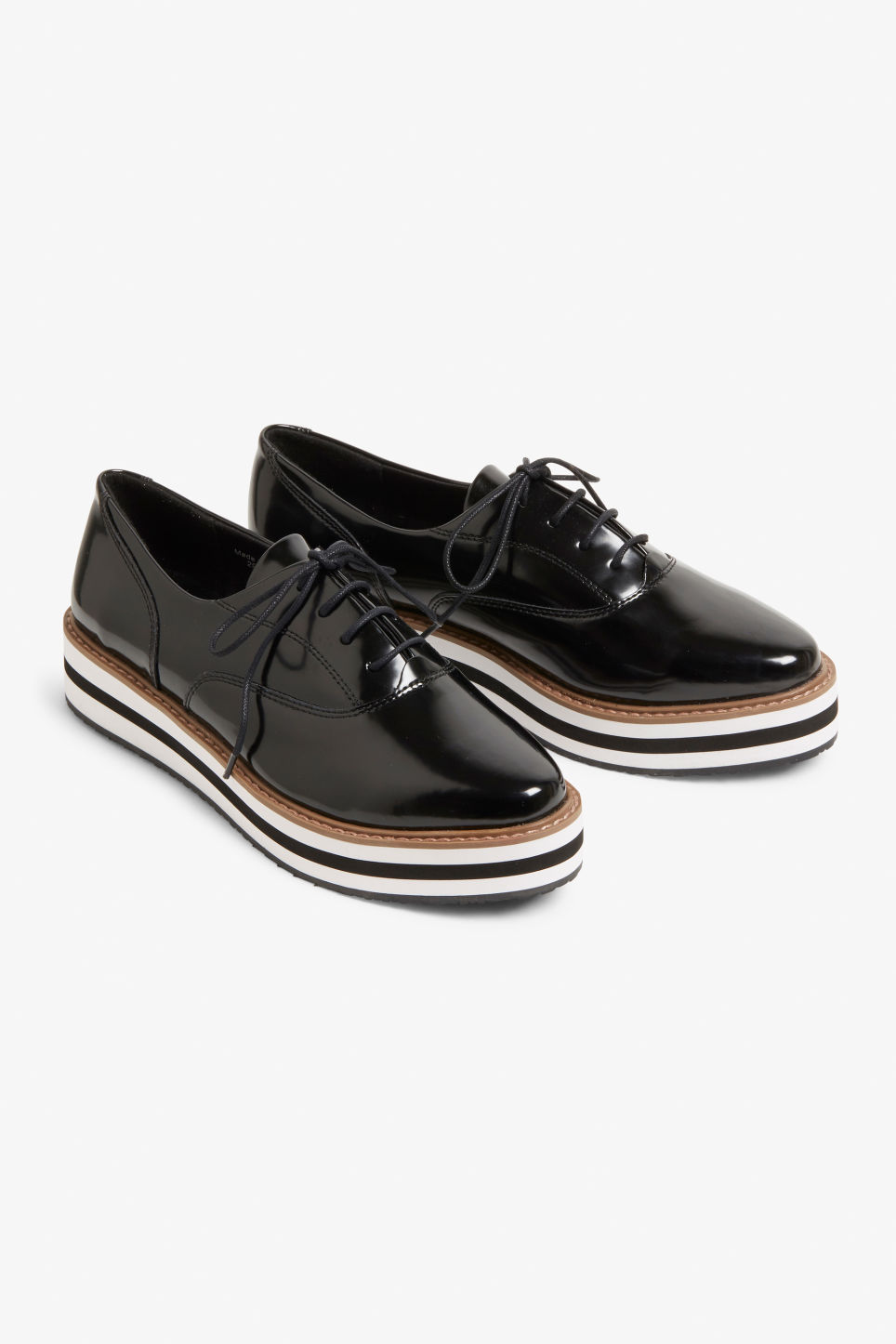 Front image of Monki flatform sneaker in black