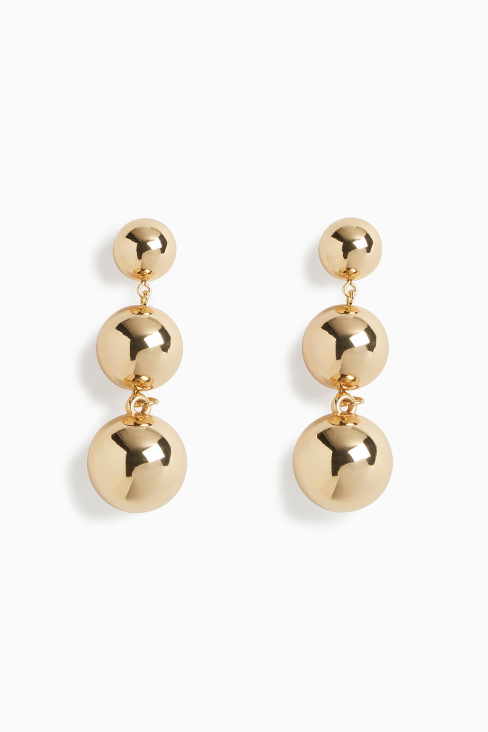 Front image of Monki gold drop earrings in gold