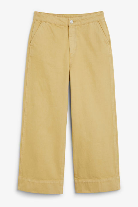 Front image of Monki wide denim trousers in yellow