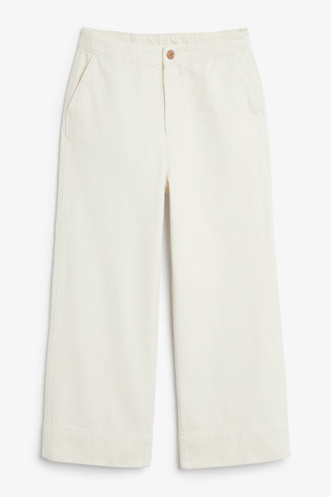 Front image of Monki wide denim trousers in white