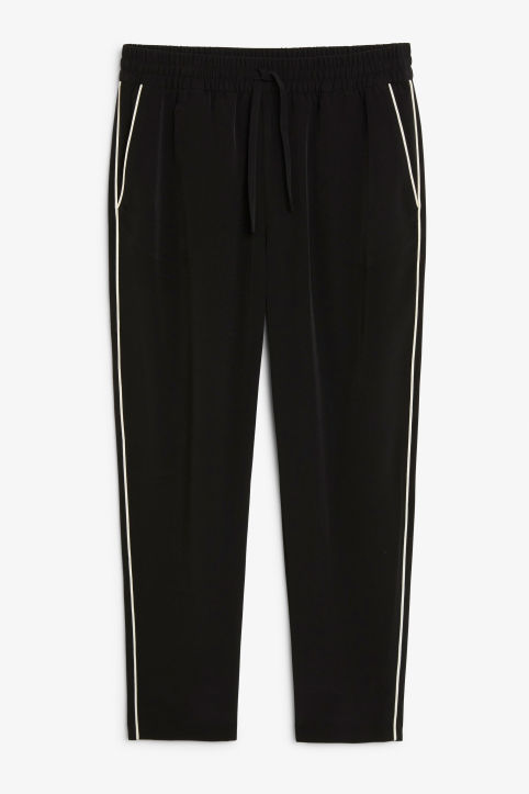 Front image of Monki rainbow side stripe trousers in black