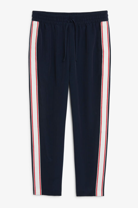 Front image of Monki rainbow side stripe trousers in blue