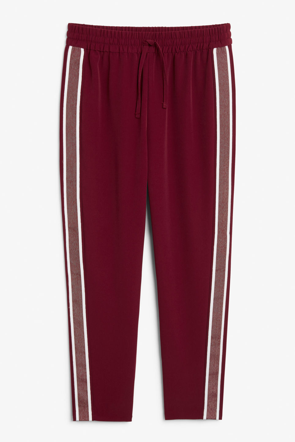 Front image of Monki side stripe trousers in red
