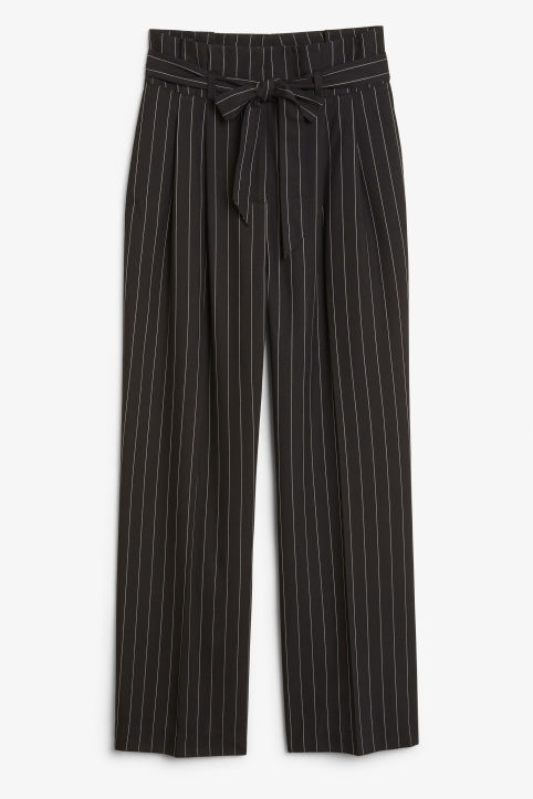 Front image of Monki smart trousers with tie detail in black