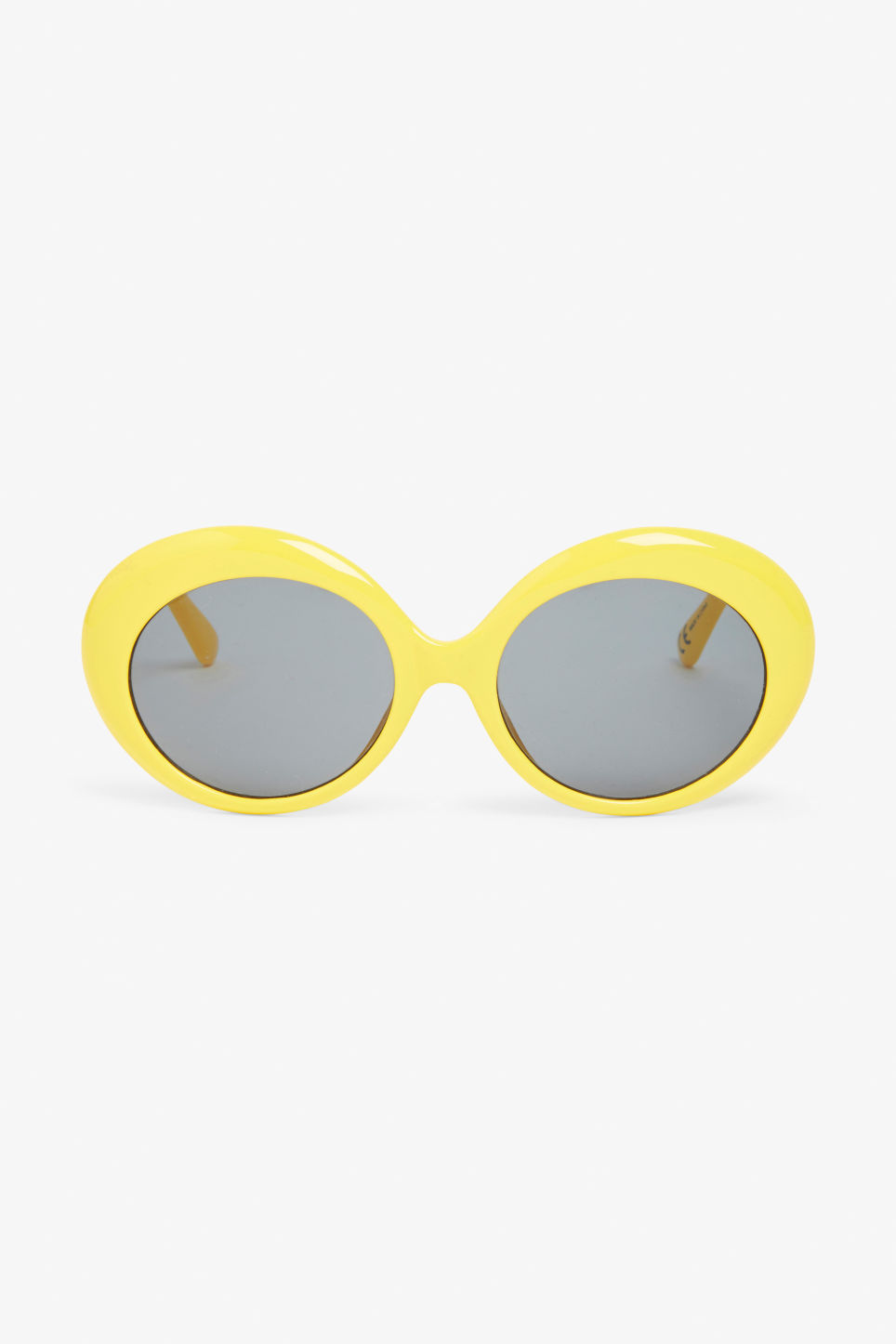 Front image of Monki retro oval sunglasses in yellow